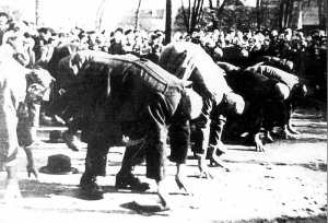 A group of Jewish men being humiliated before a crowd - courtesy of Yad Vashem archives